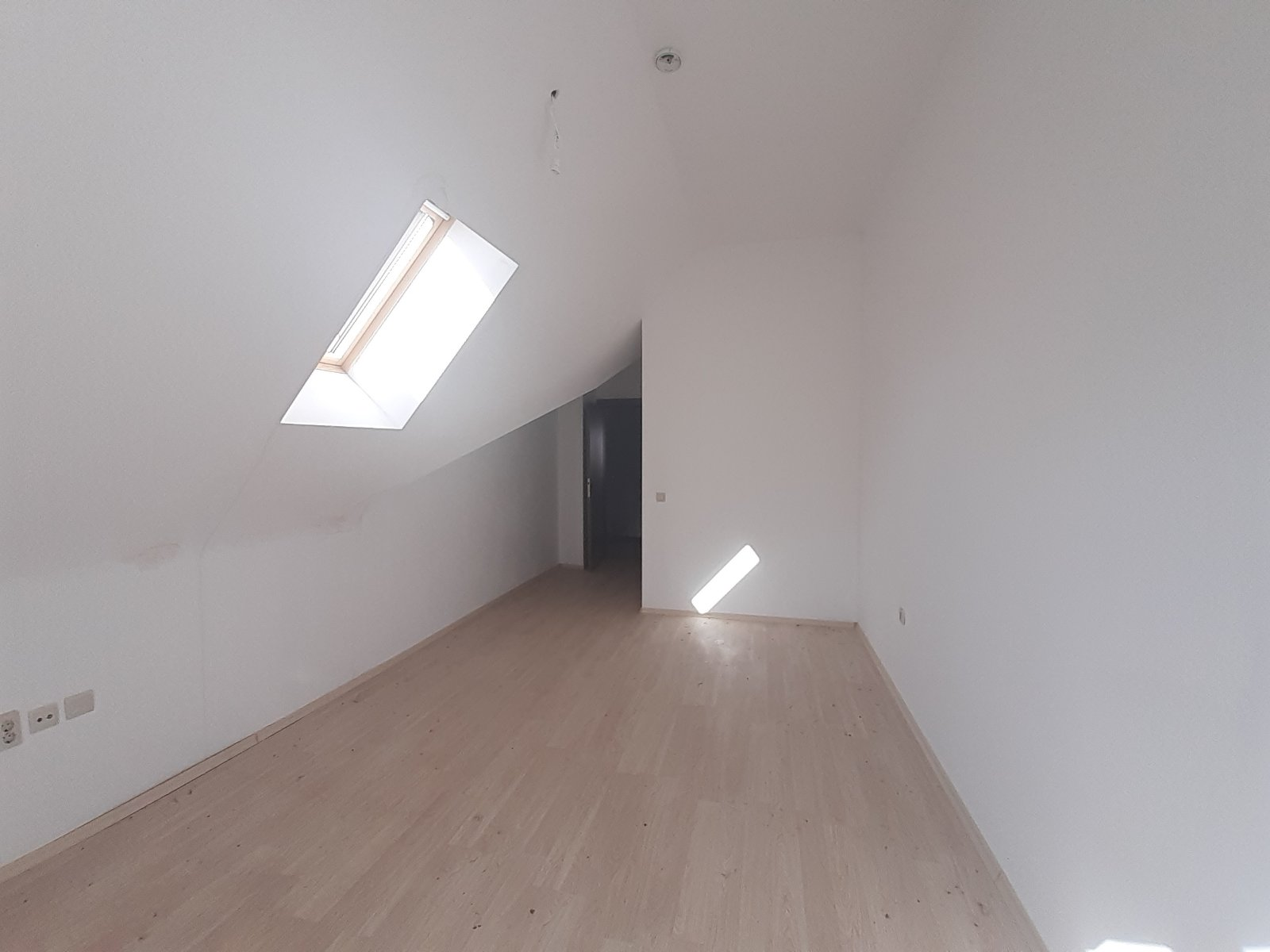 unfurnished two-bedroom penthouse with low maintenance fee